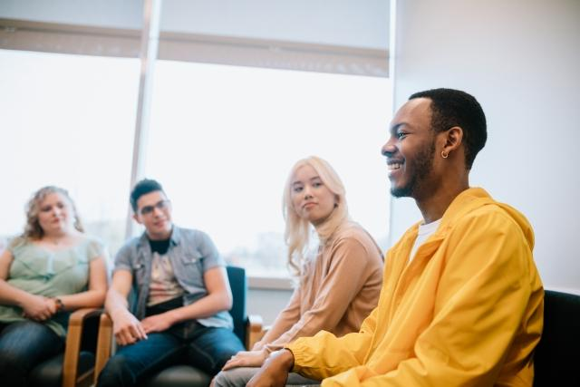 Patients in a group therapy environment