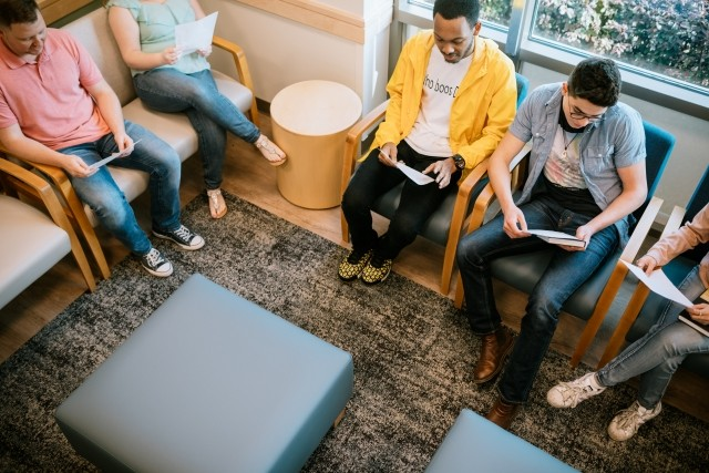 Patients talking in a group session in treatment