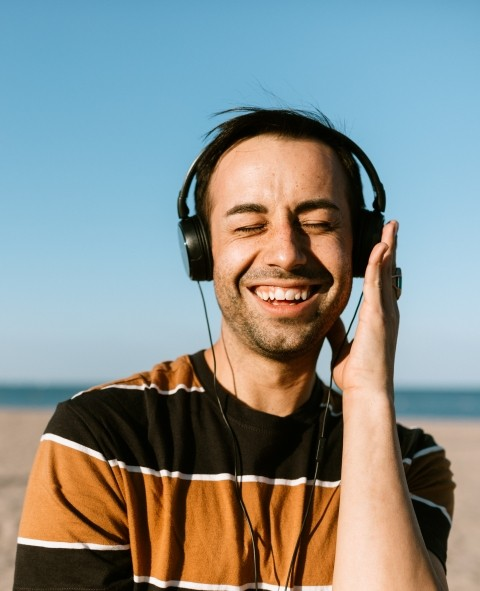 Eric Dorsa listening to music at the beach